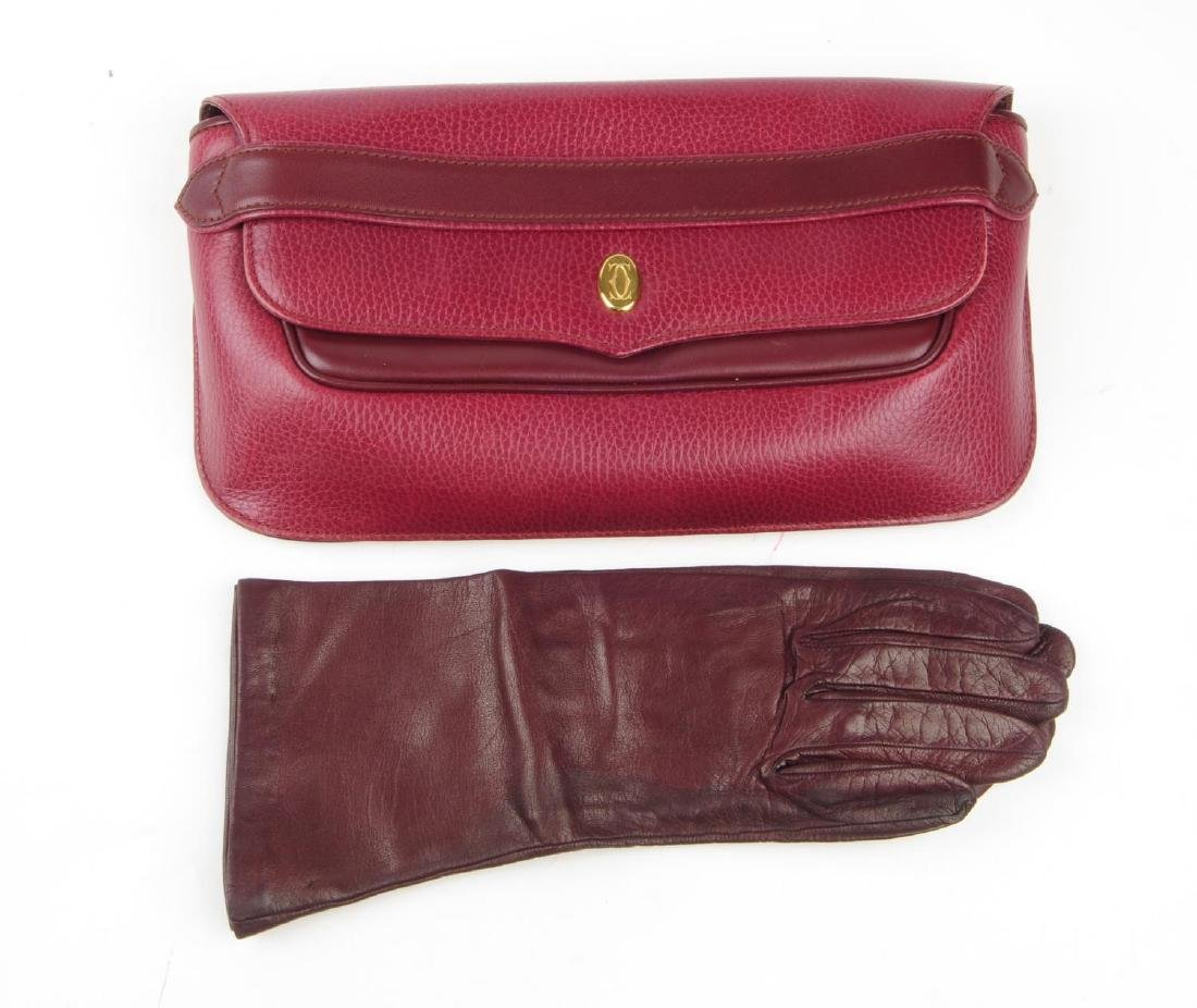 CARTIER - a Bordeaux leather clutch and a pair of - 7