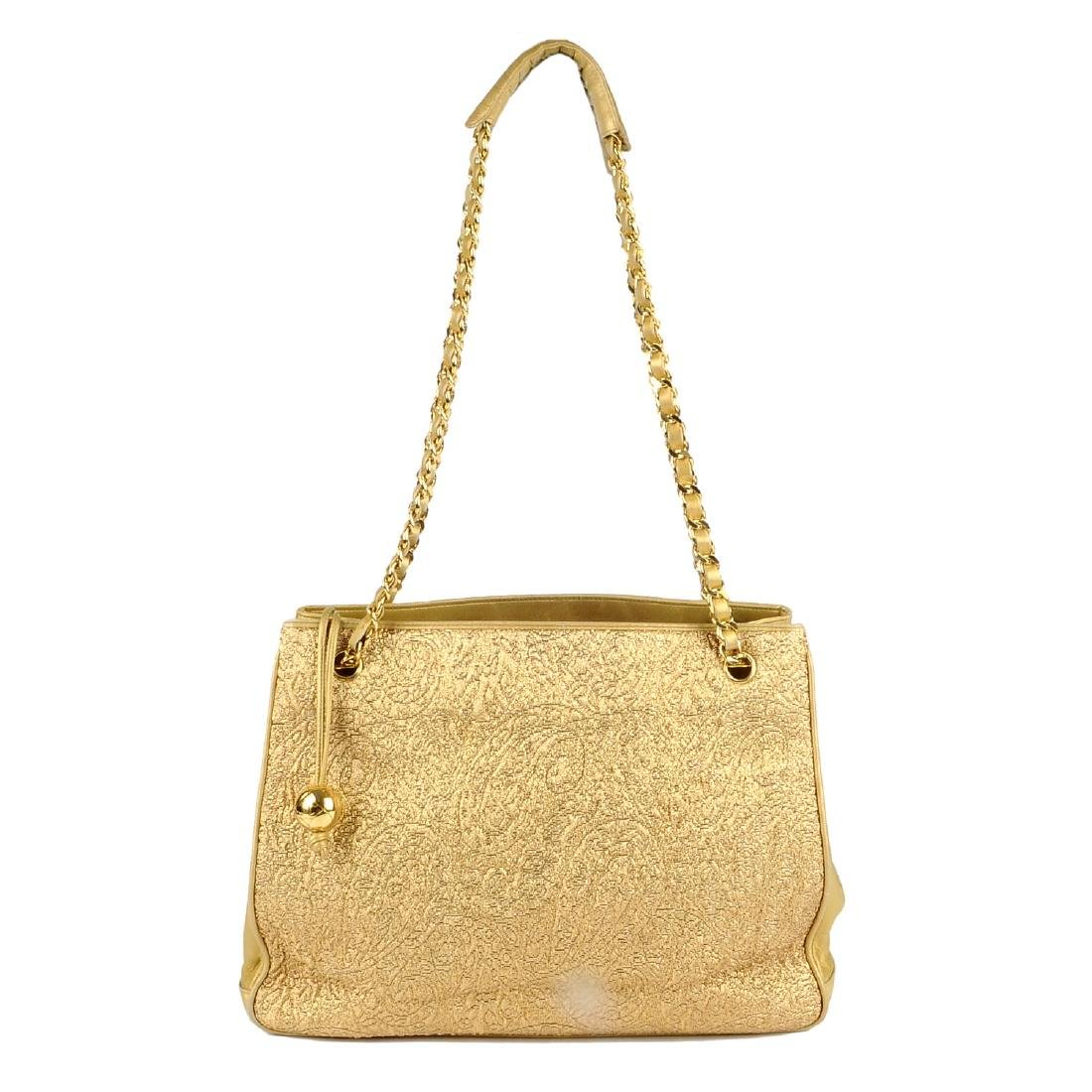CHANEL - an early 90s gold lamé handbag. Designed with