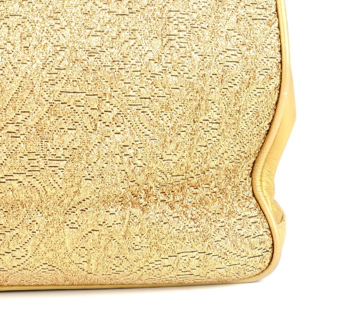 CHANEL - an early 90s gold lamé handbag. Designed with - 2