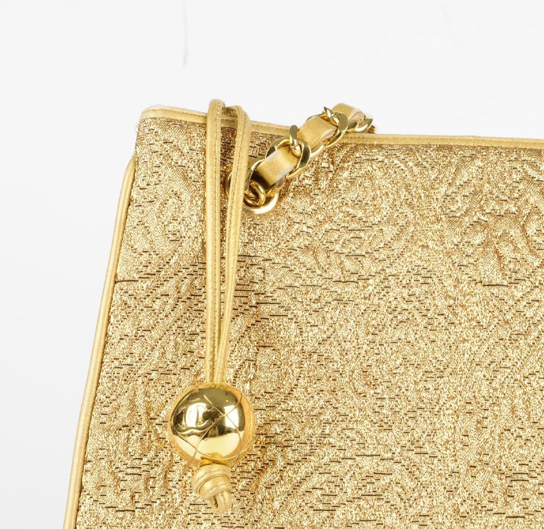 CHANEL - an early 90s gold lamé handbag. Designed with - 3