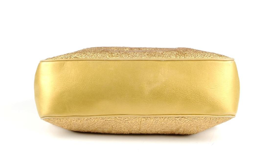 CHANEL - an early 90s gold lamé handbag. Designed with - 4
