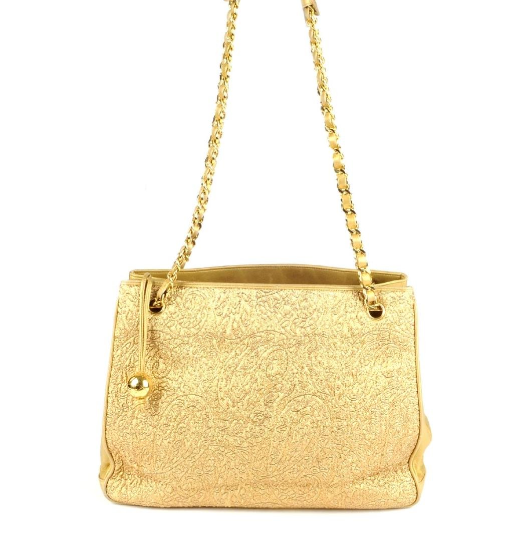 CHANEL - an early 90s gold lamé handbag. Designed with - 5