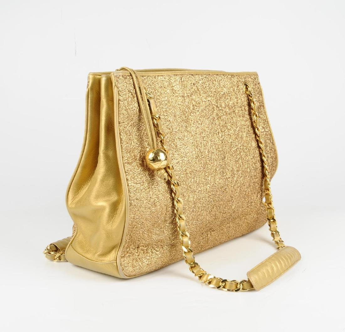 CHANEL - an early 90s gold lamé handbag. Designed with - 6