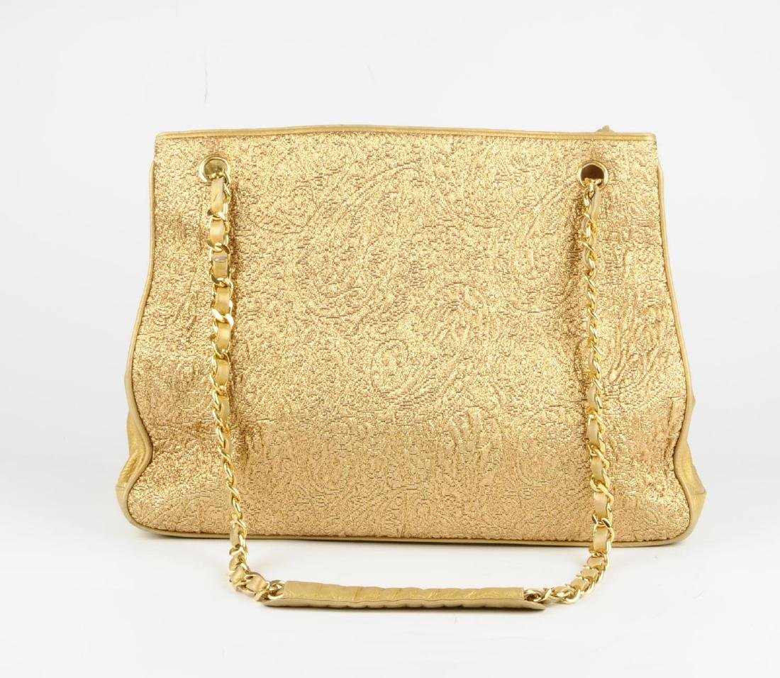 CHANEL - an early 90s gold lamé handbag. Designed with - 7