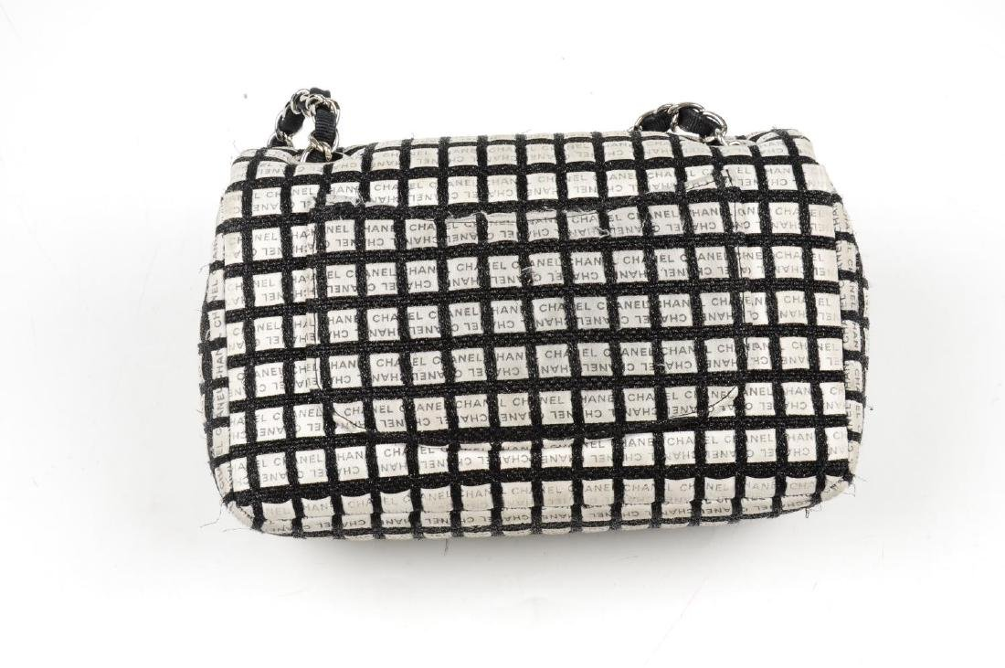 CHANEL - a black and white woven New Mini Flap handbag. - 2