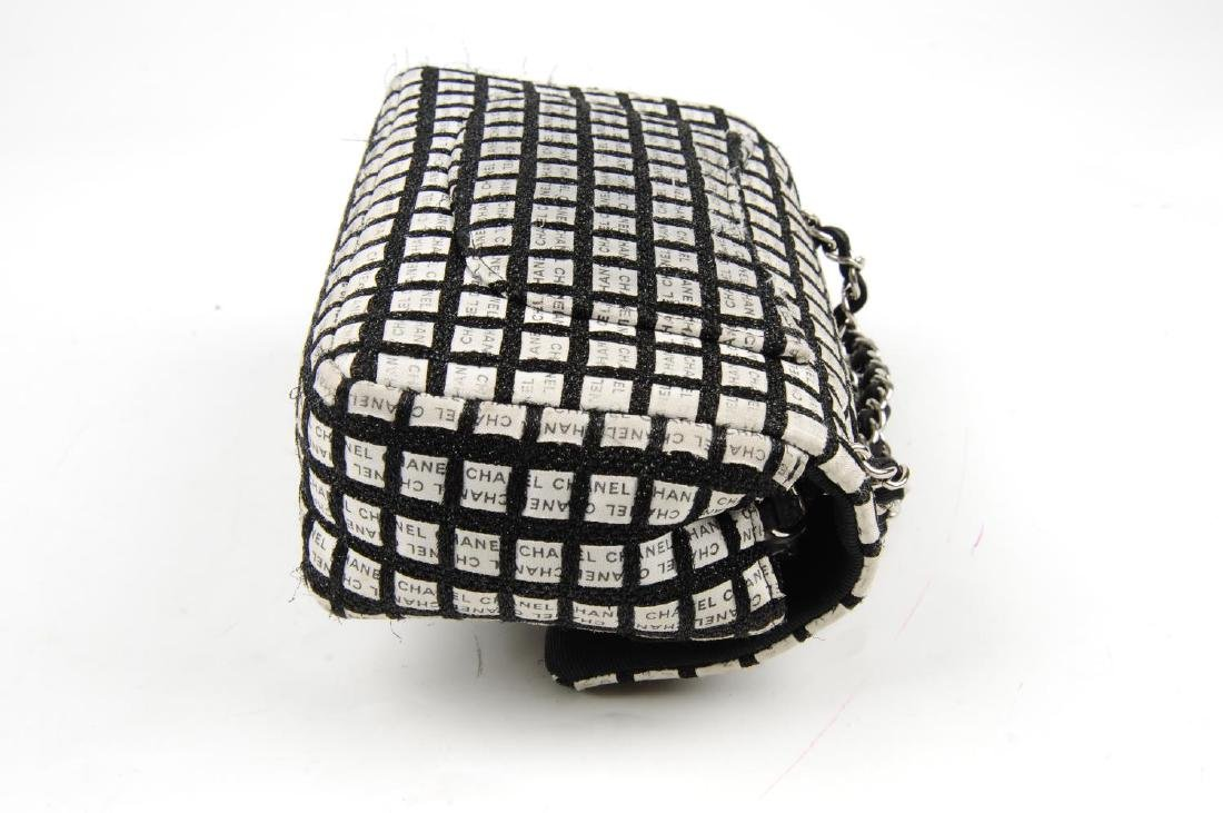 CHANEL - a black and white woven New Mini Flap handbag. - 4