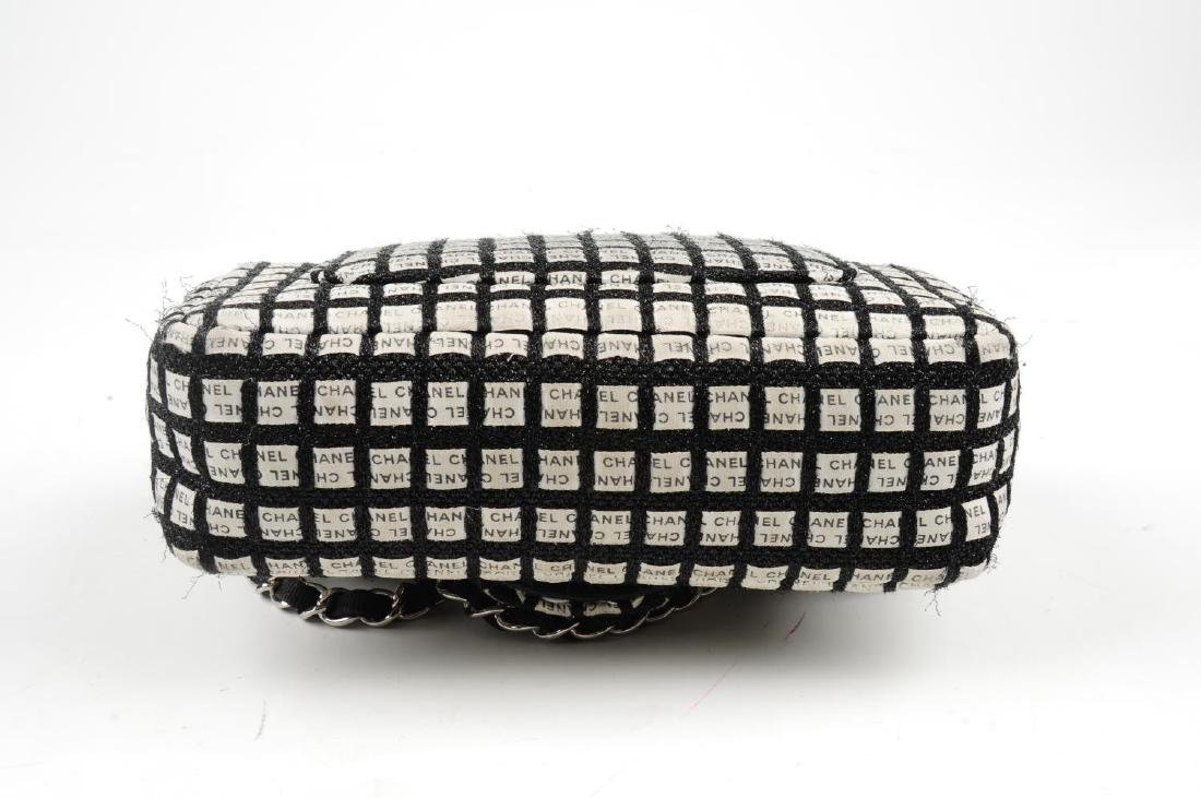 CHANEL - a black and white woven New Mini Flap handbag. - 5