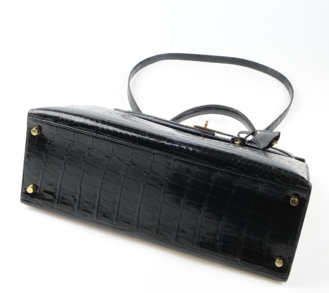 HERMÈS - a black Porosus Crocodile Kelly 35 handbag. - 10