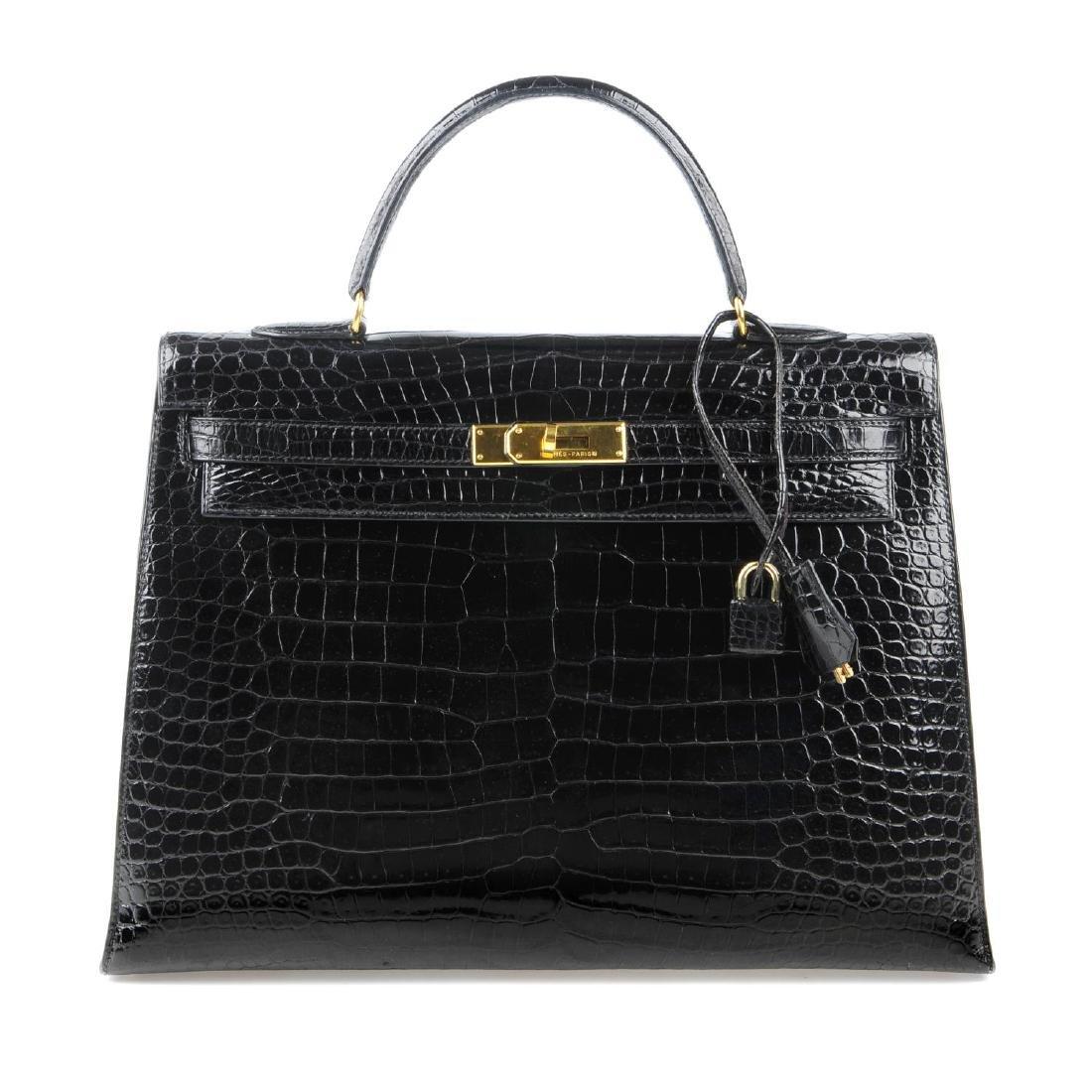 HERMÈS - a black Porosus Crocodile Kelly 35 handbag.