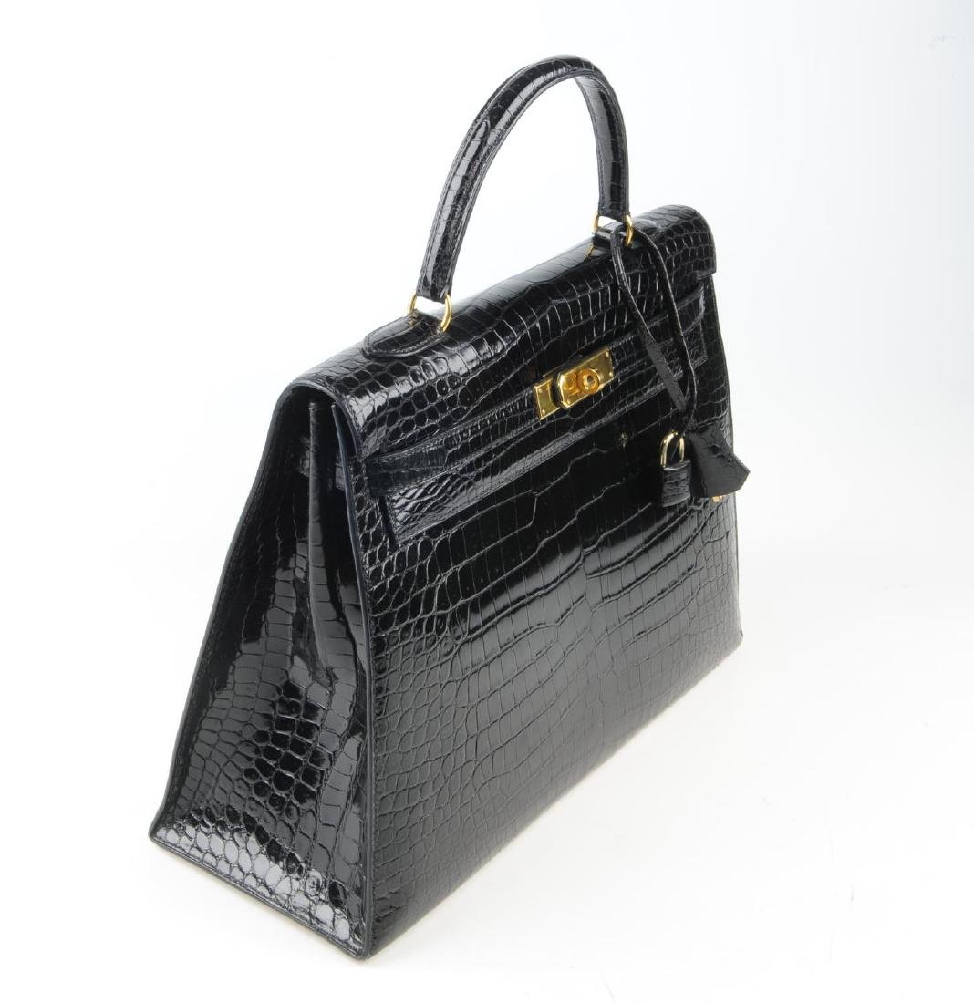 HERMÈS - a black Porosus Crocodile Kelly 35 handbag. - 2