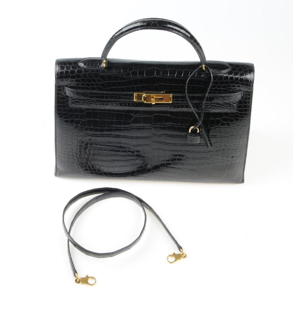 HERMÈS - a black Porosus Crocodile Kelly 35 handbag. - 4