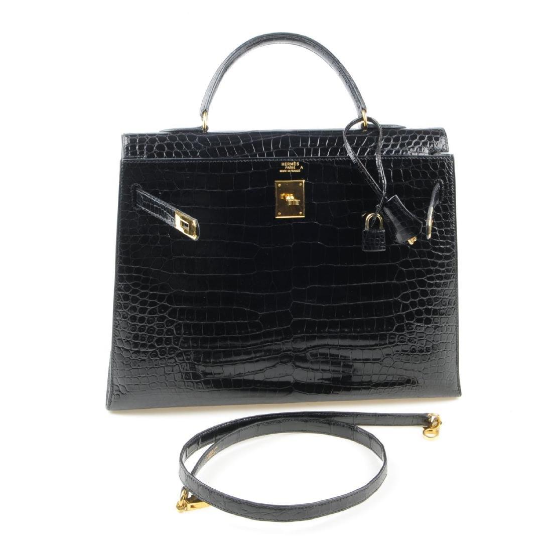 HERMÈS - a black Porosus Crocodile Kelly 35 handbag. - 5