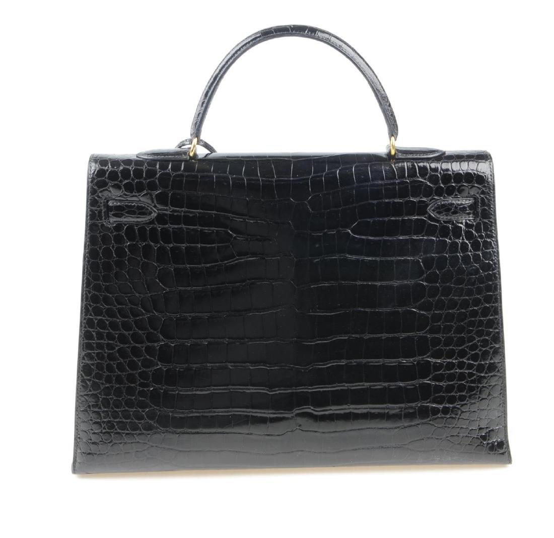 HERMÈS - a black Porosus Crocodile Kelly 35 handbag. - 6