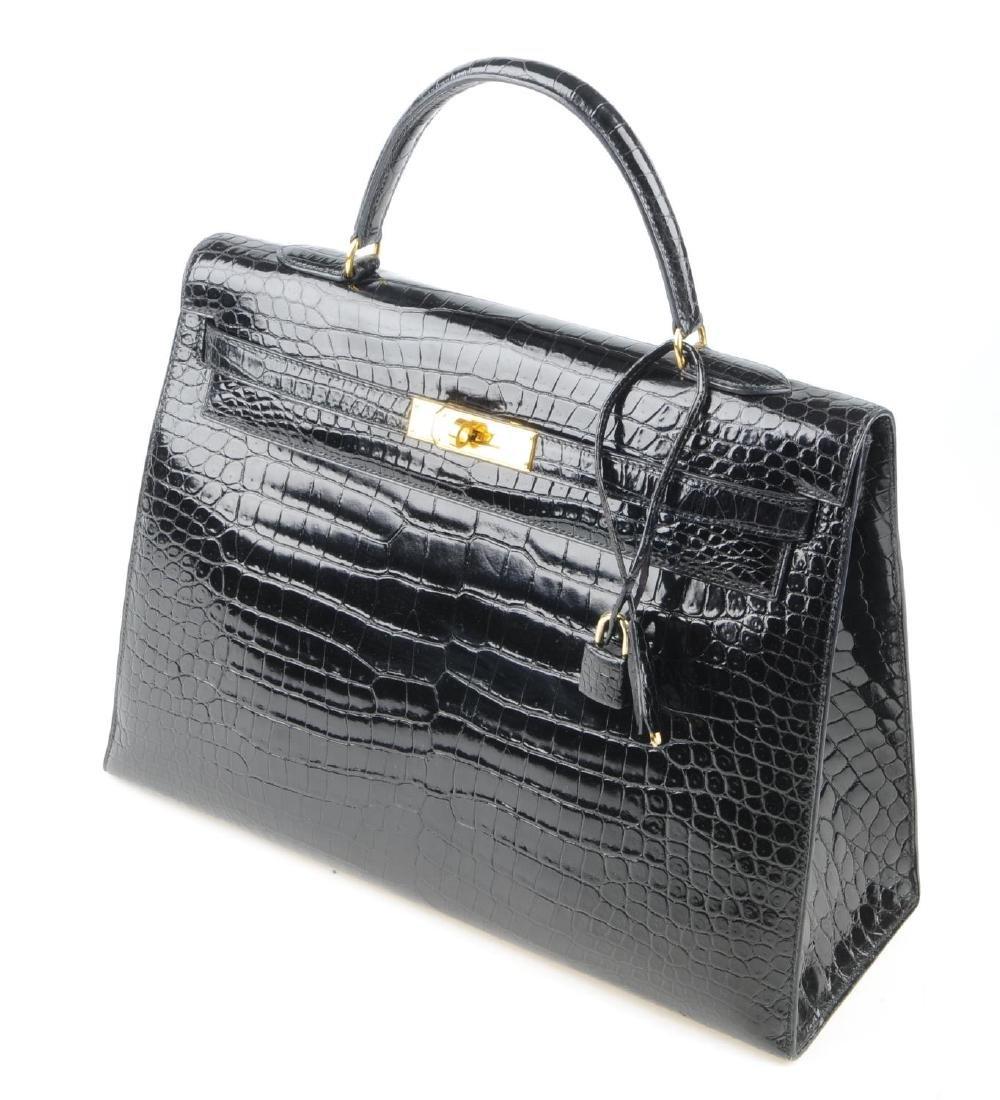 HERMÈS - a black Porosus Crocodile Kelly 35 handbag. - 7