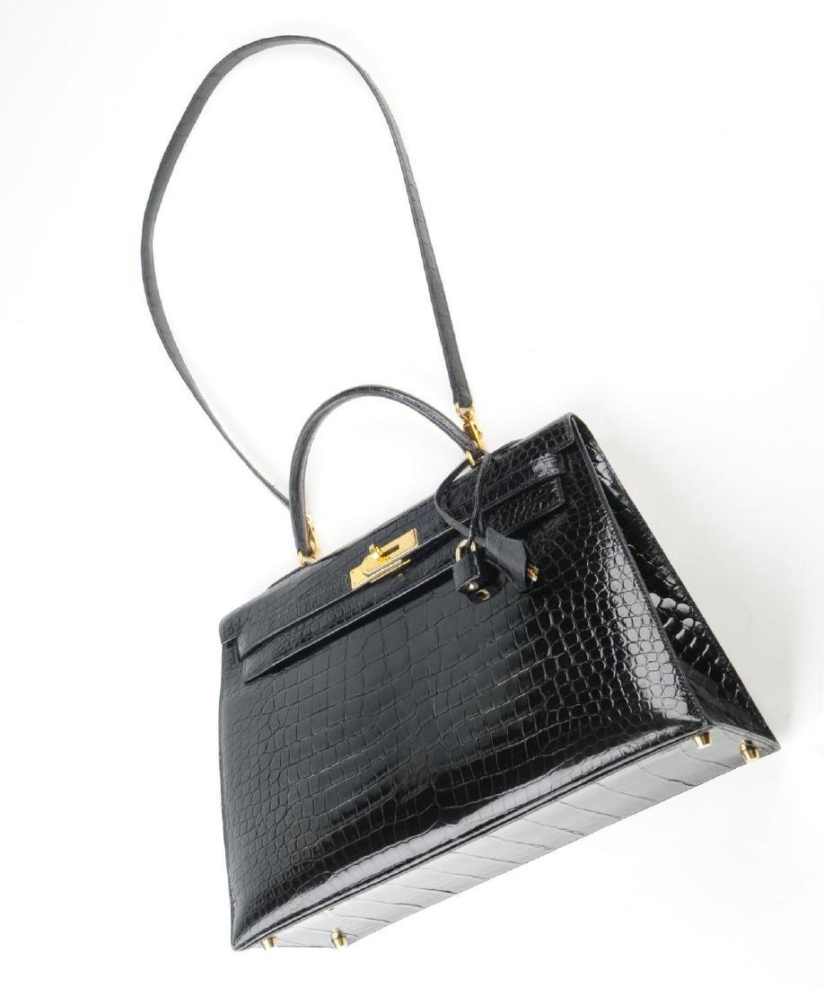HERMÈS - a black Porosus Crocodile Kelly 35 handbag. - 9