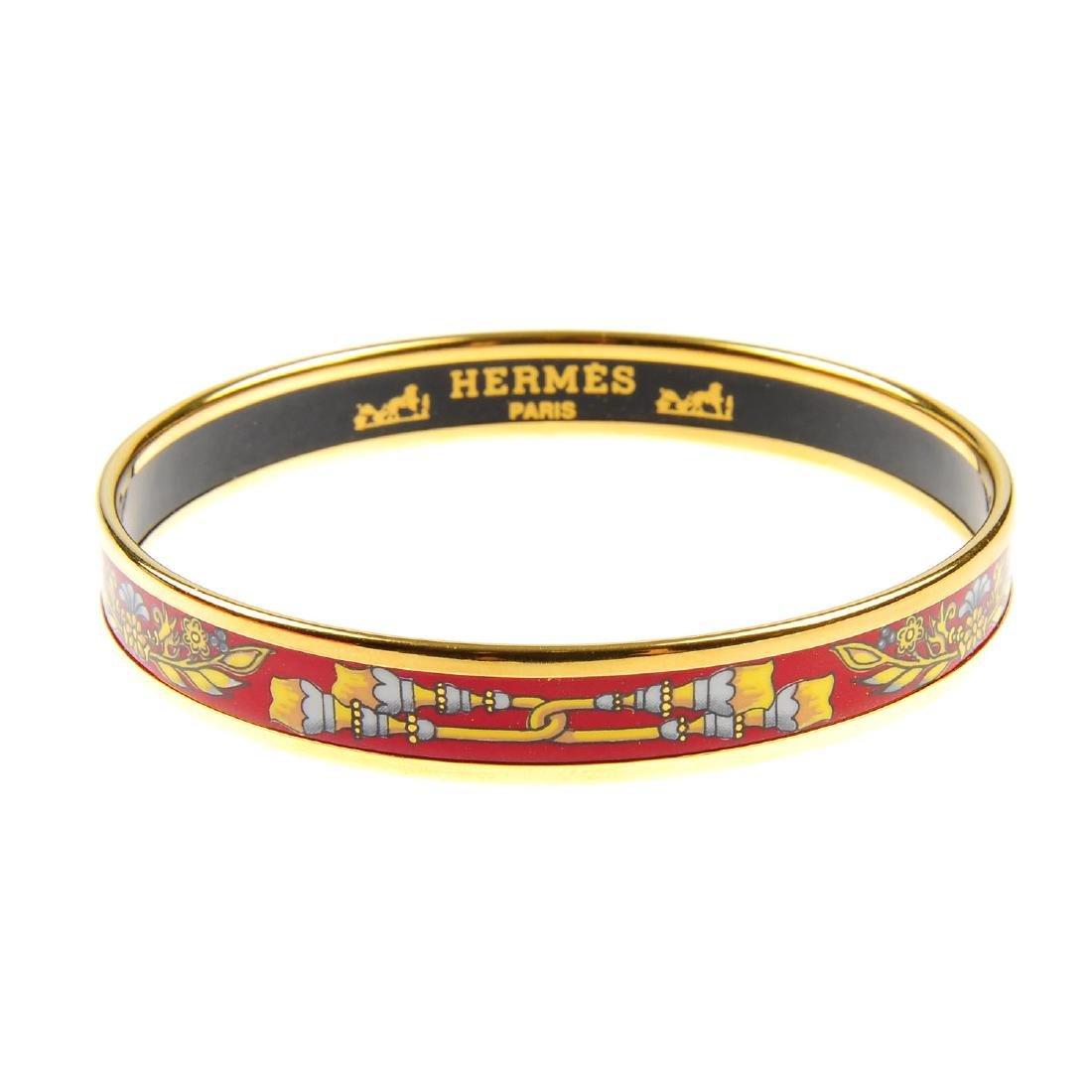 HERMÈS - an enamel bangle. With gold-tone edge, the