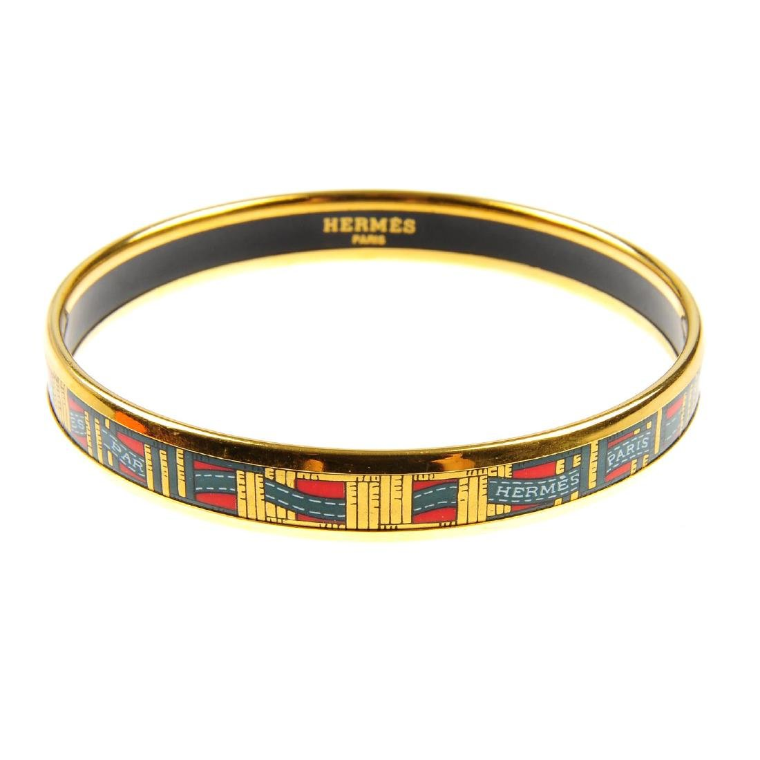 HERMÈS - an enamel bangle. Designed with the maker's