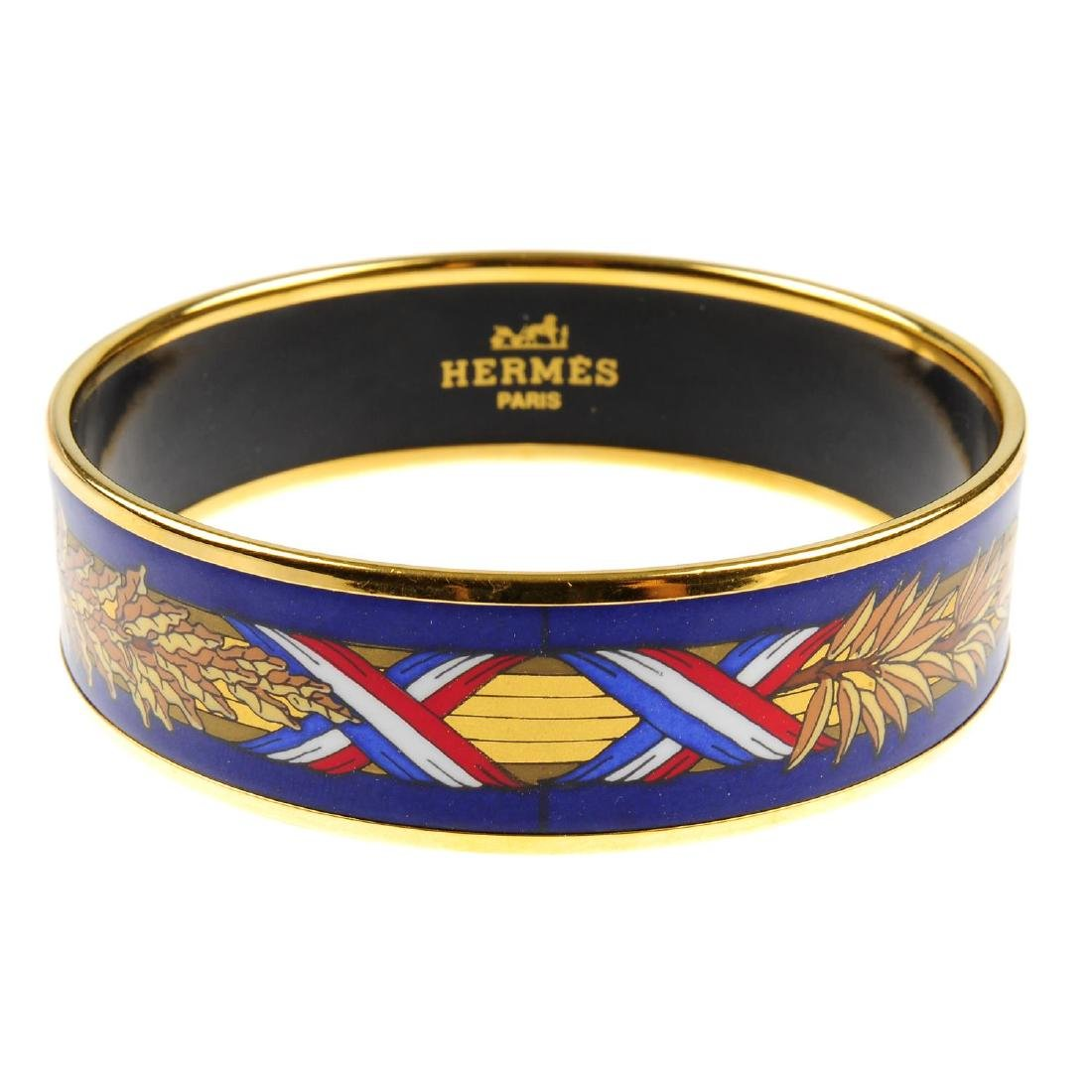 HERMÈS - an enamel bangle. The design features red,