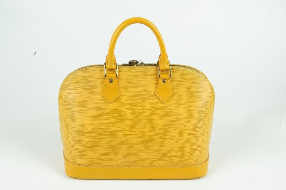 LOUIS VUITTON - an Epi Alma PM handbag. Designed with a - 2
