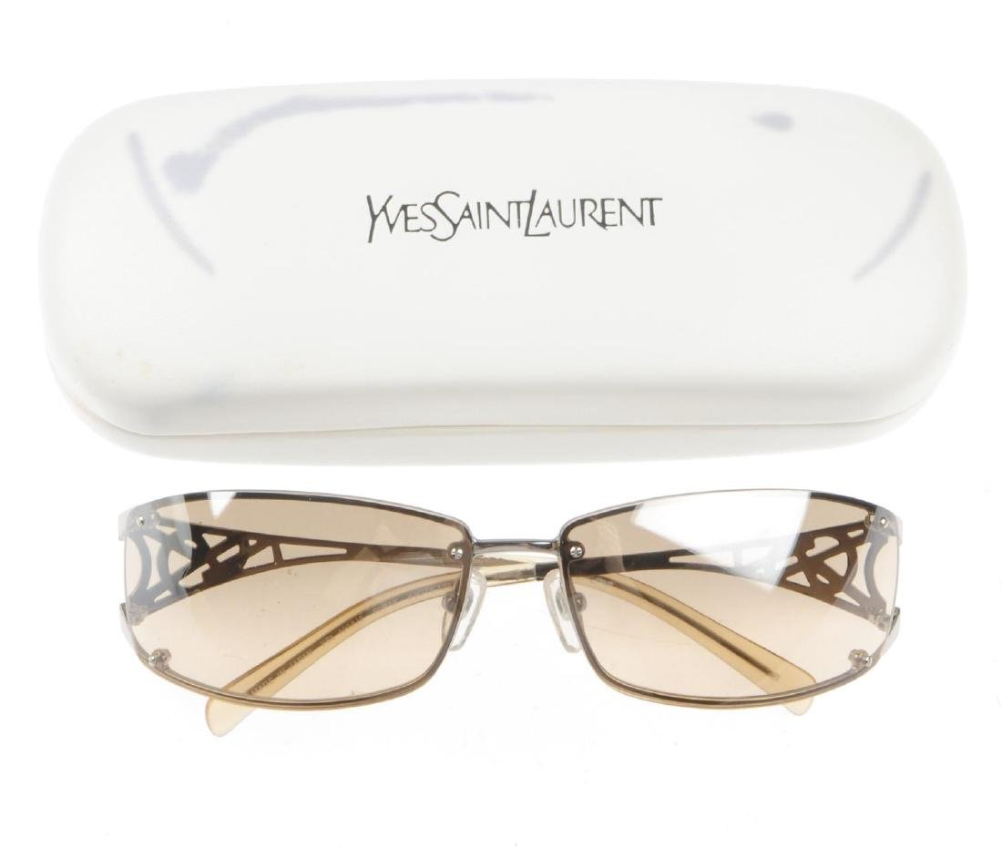 Three pairs of designer sunglasses. To include a pair - 2