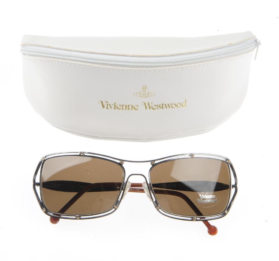 Three pairs of designer sunglasses. To include a pair - 4