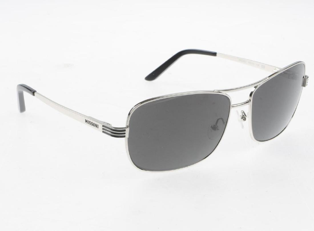 Three pairs of designer sunglasses. To include a pair - 7