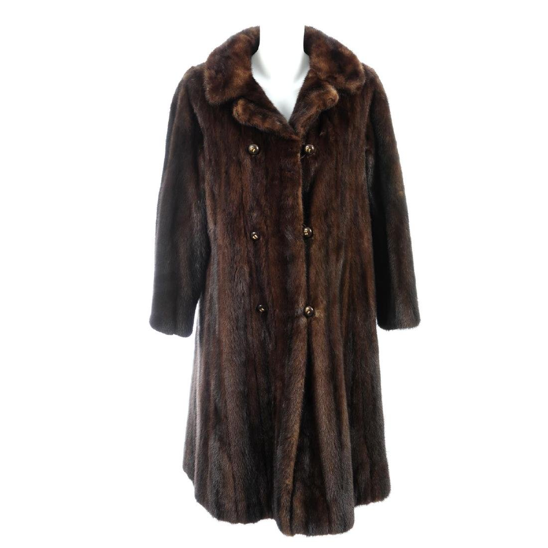 A knee-length ranch mink coat. Featuring a notched