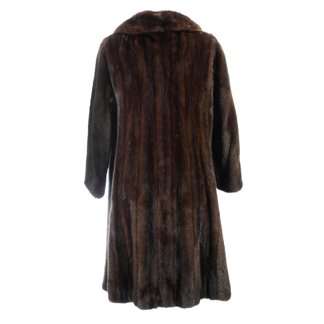 A knee-length ranch mink coat. Featuring a notched - 2