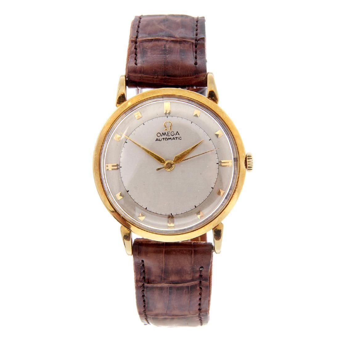 OMEGA - a gentleman's wrist watch. Yellow metal case,
