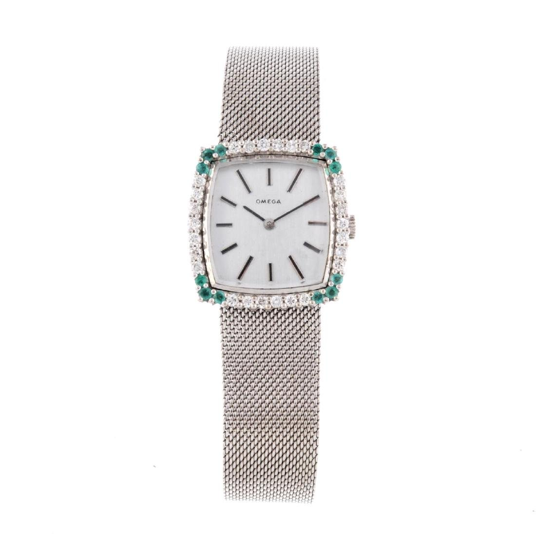 OMEGA - a lady's bracelet watch. White metal factory