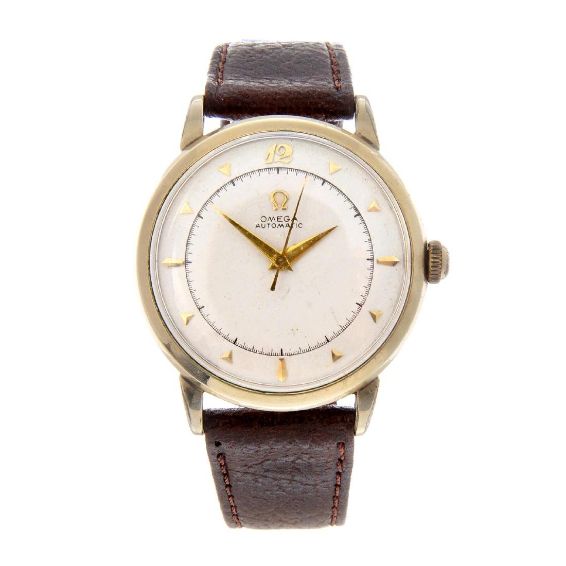OMEGA - a gentleman's wrist watch. Gold filled case.