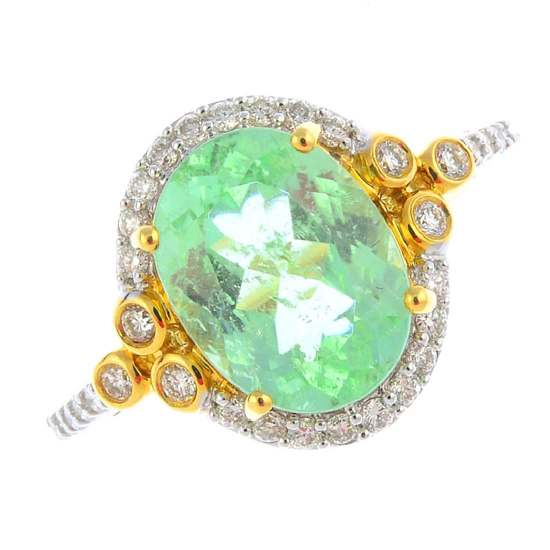 An 18ct gold tourmaline and diamond cluster ring. The