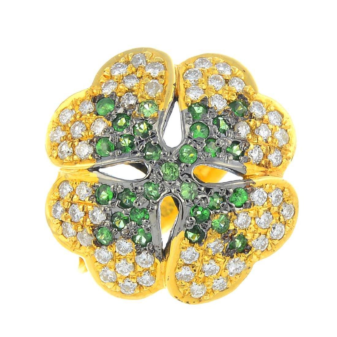 A tsavorite garnet and diamond clover ring. Of