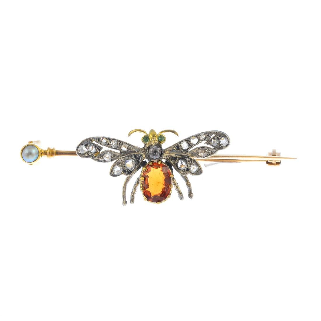 An early 20th century gold, diamond and gem-set brooch.