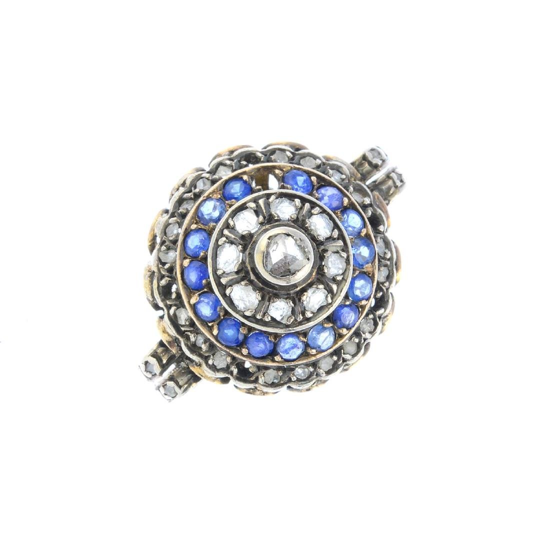 A sapphire and diamond jewellery component. The