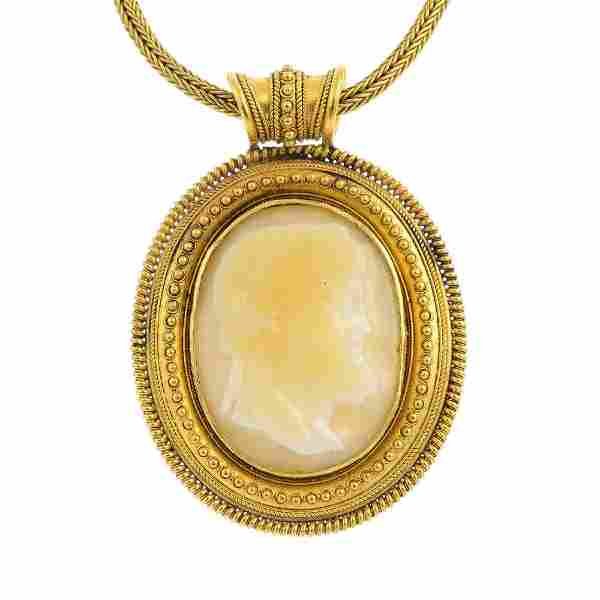 A late Victorian gold agate cameo pendant. The oval