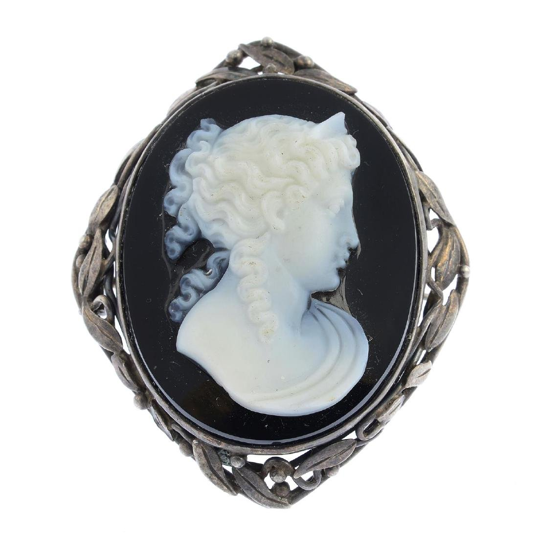 An early 20th century silver onyx cameo brooch. The