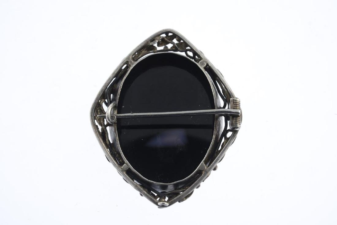 An early 20th century silver onyx cameo brooch. The - 2