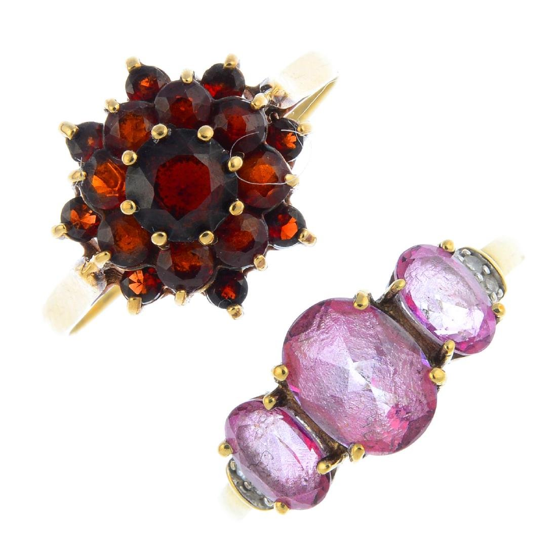 Four 9ct gold gem-set rings. To include a pink coated