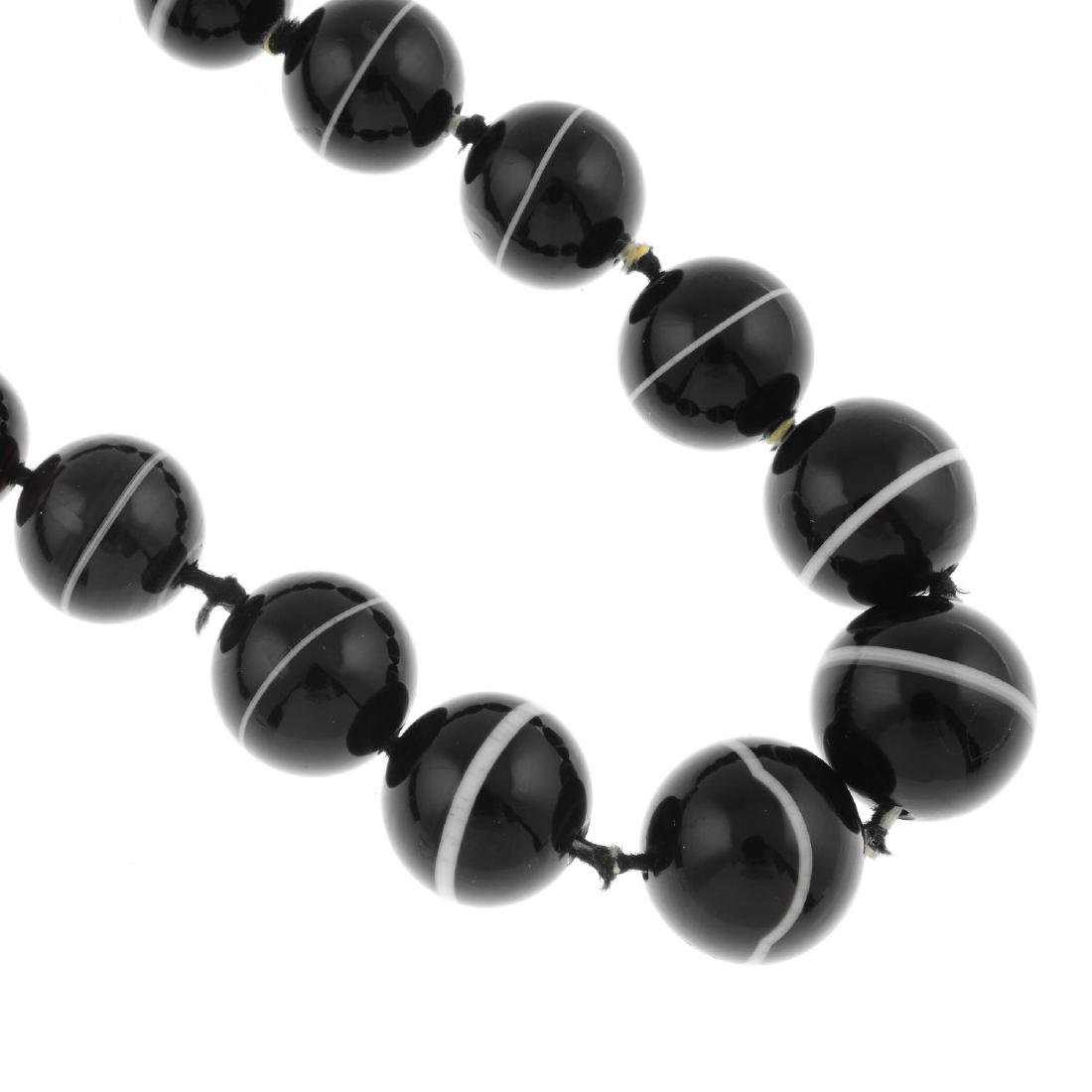 A banded agate bead necklace. The single row of