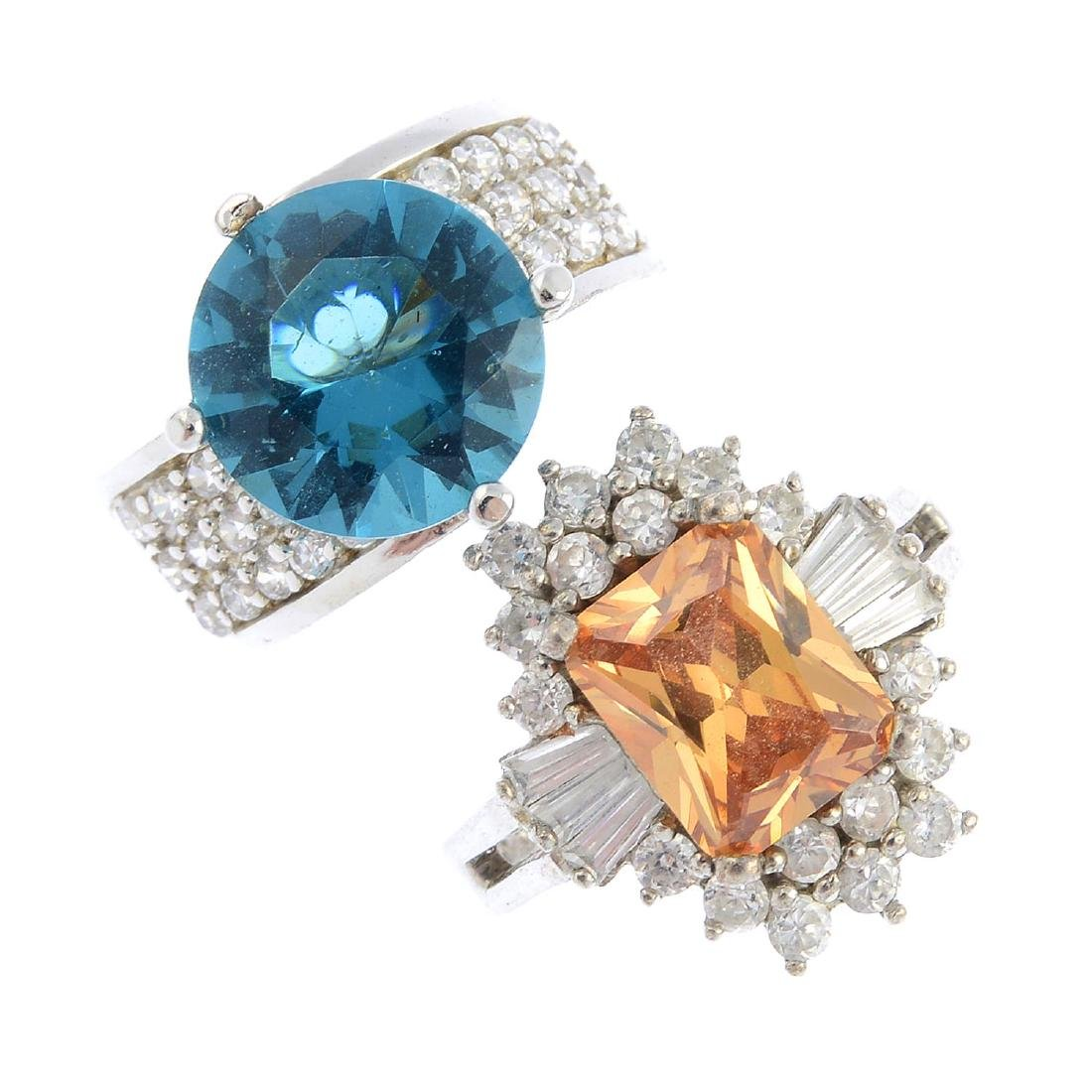 Twenty-eight rings. To include a blue cubic zirconia