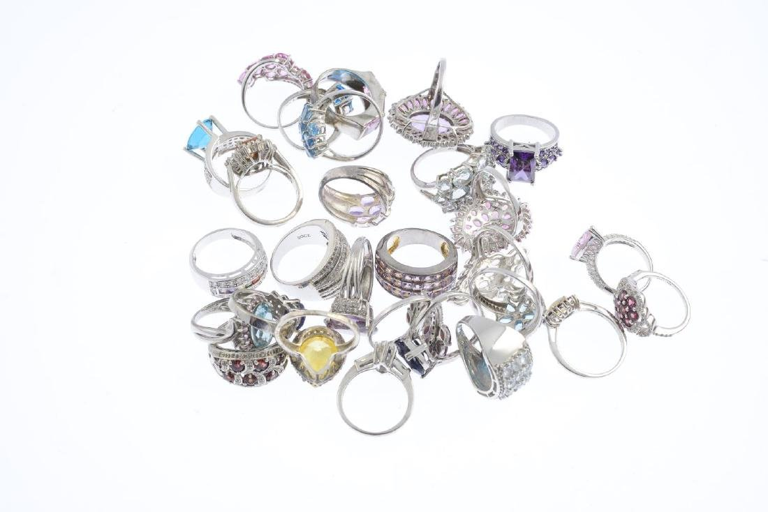 Twenty-eight rings. To include a blue cubic zirconia - 2