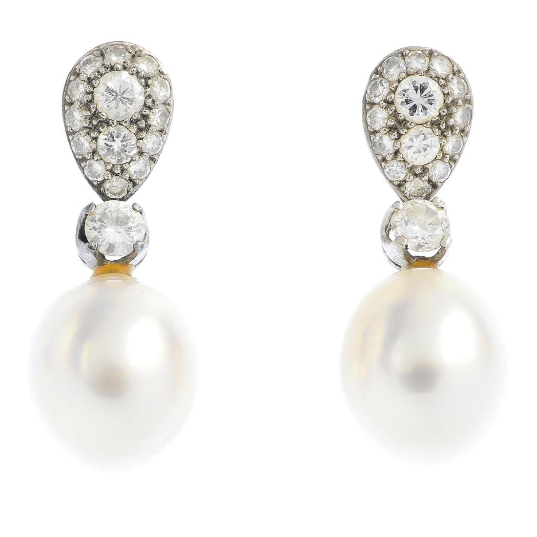 (209112) A pair of cultured pearl and diamond earrings.