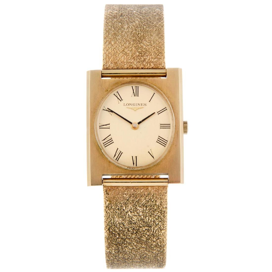 LONGINES - a gentleman's bracelet watch. 9ct yellow