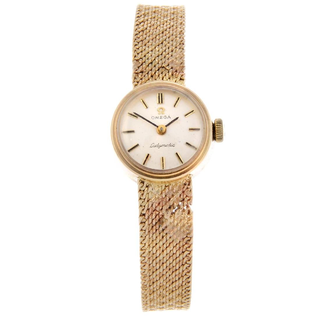 OMEGA - a lady's Ladymatic bracelet watch. 9ct yellow