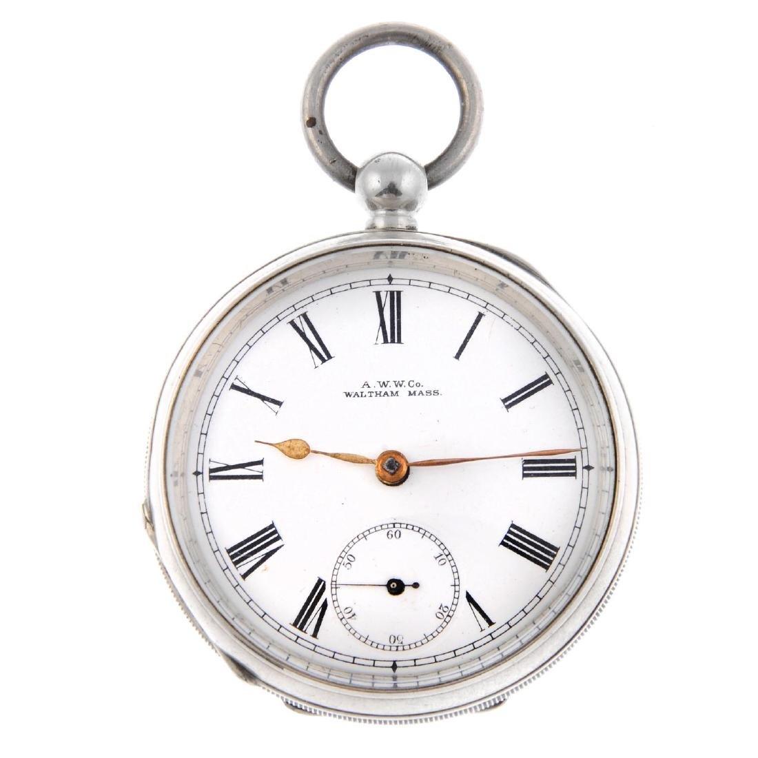 An open face pocket watch by Waltham. Silver case,
