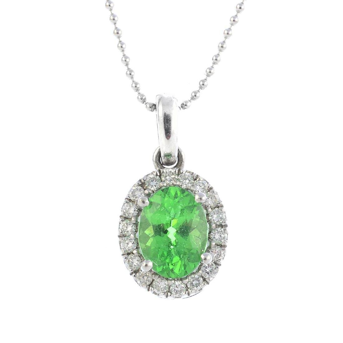 A tsavorite garnet and diamond cluster pendant. The