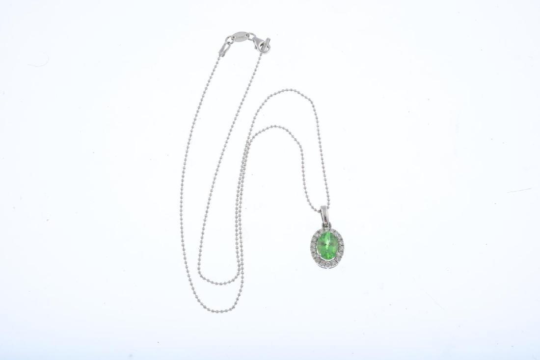A tsavorite garnet and diamond cluster pendant. The - 3