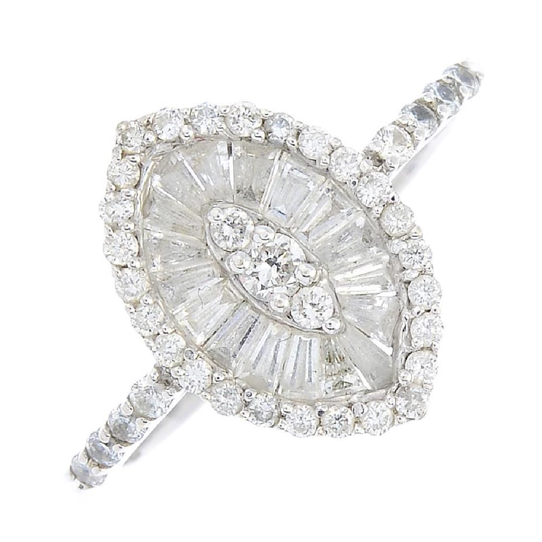 An 18ct gold diamond cluster ring. Of marquise outline,