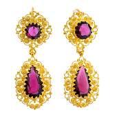 A pair of late Victorian gold garnet earrings Each